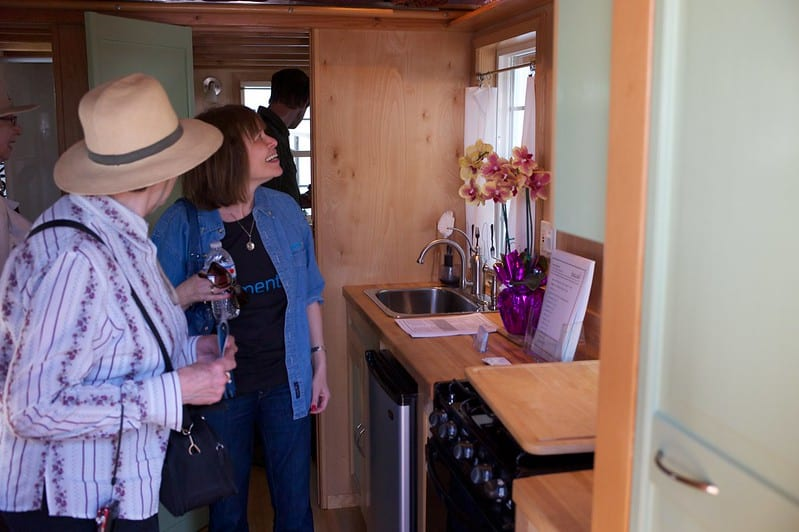group of people inside tiny house
